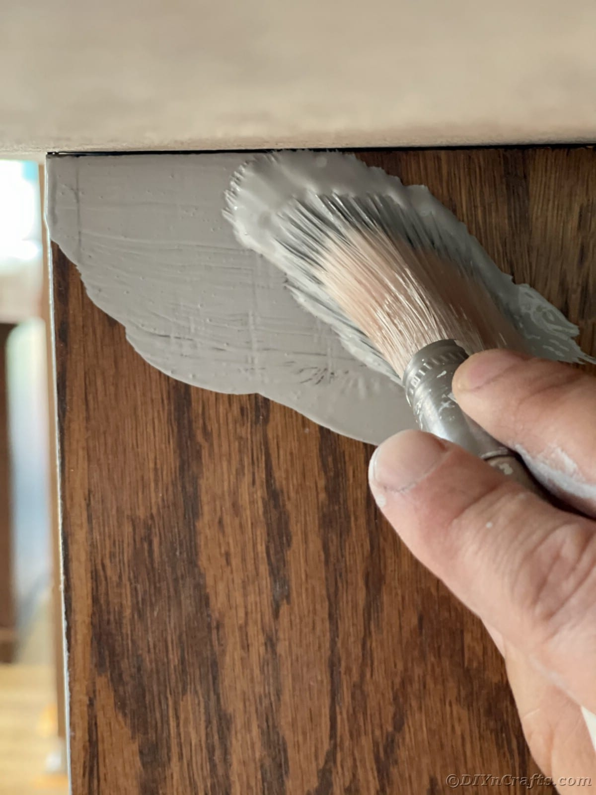 Painting woodgrain cabinet with primer