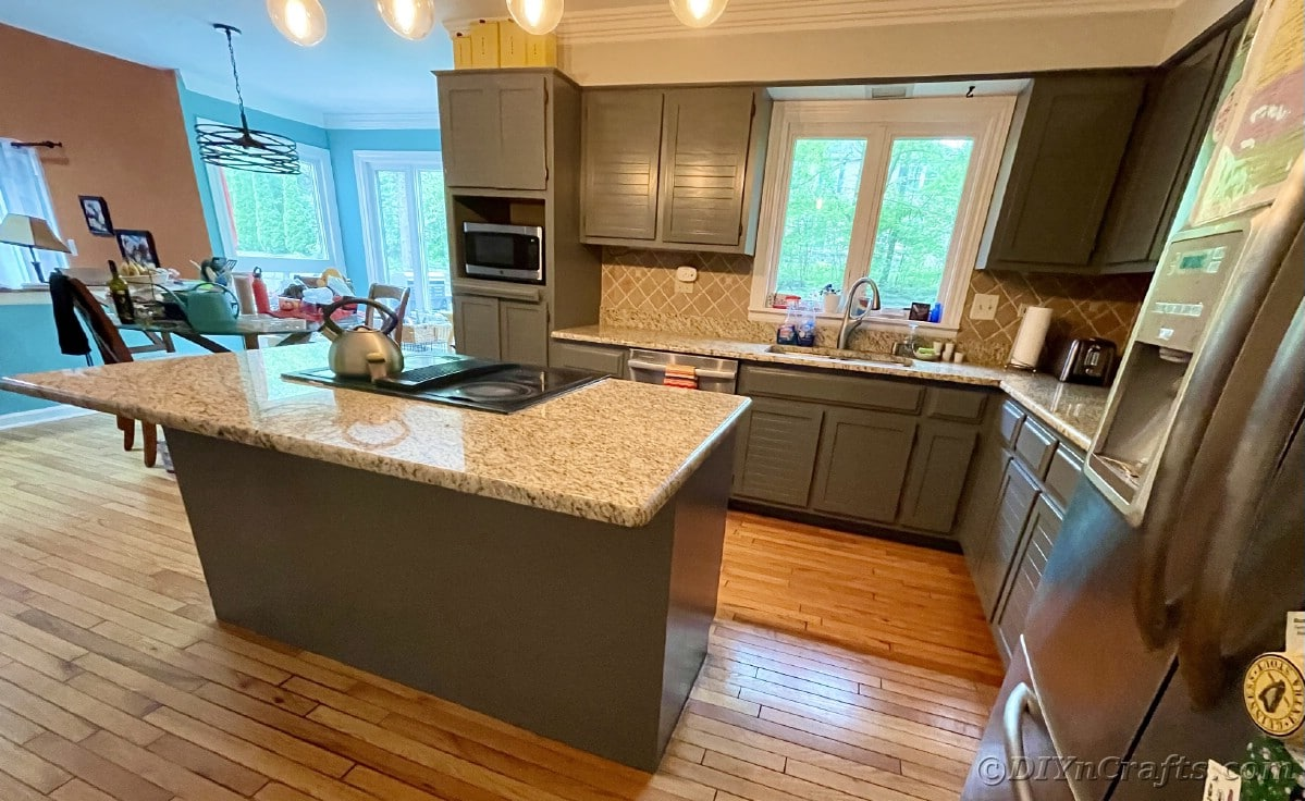 Marbled countertops in kitchen by gray cabinets