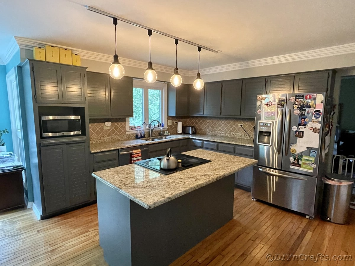 Large island in center of kitchen with gray cabinets