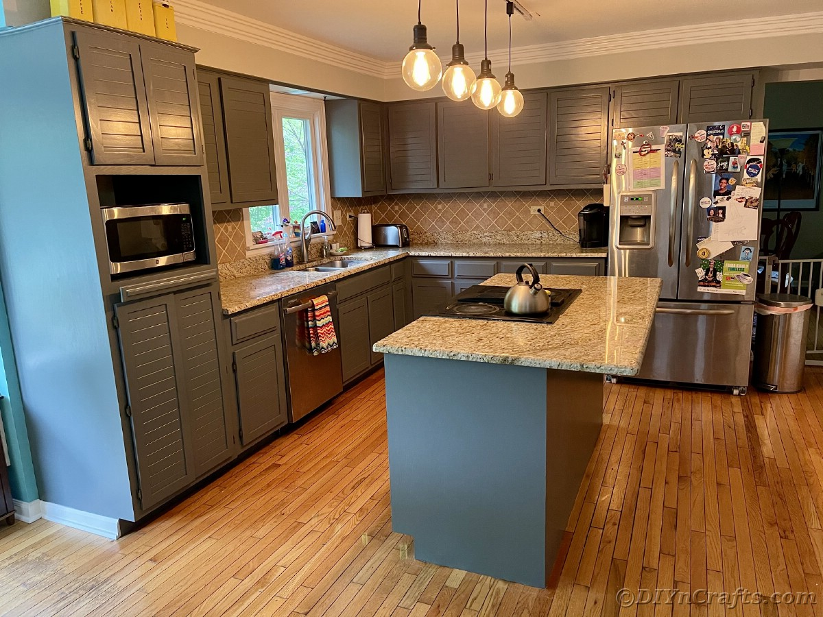 Kitchen with gray cabinets and large island