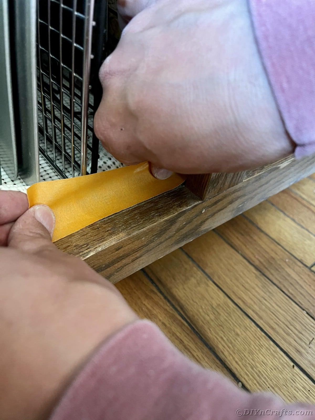 Adding paint tape around appliances