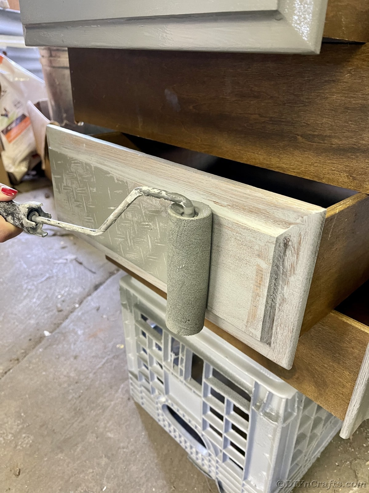 Painting front of drawer with roller