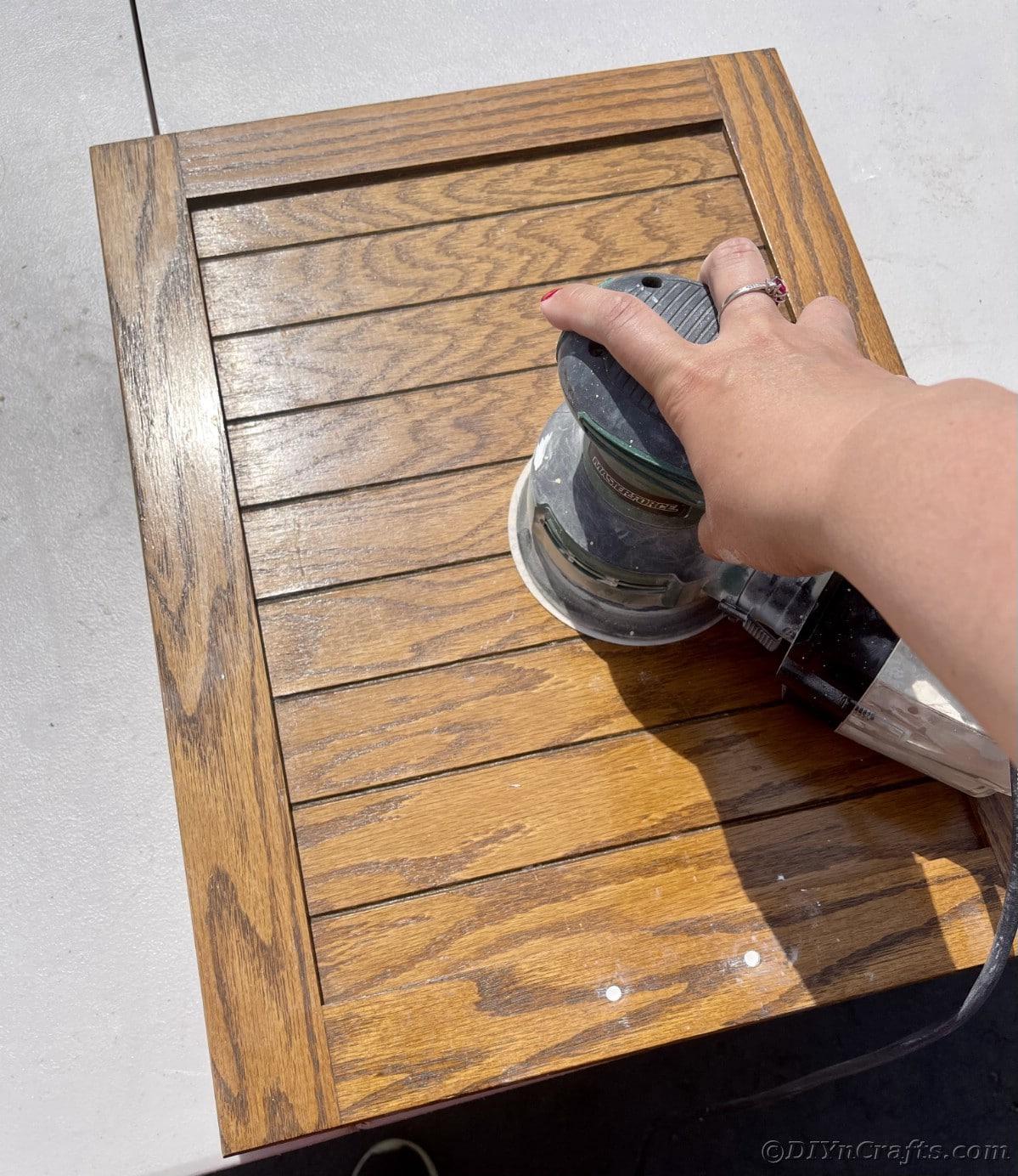 Using orbital sander on wood grain cabinet door