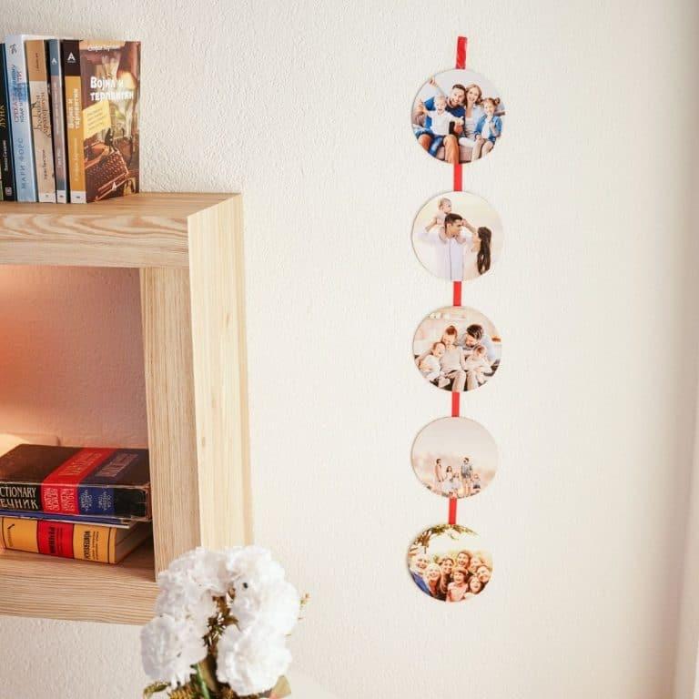Photo ribbon on wall by shelf