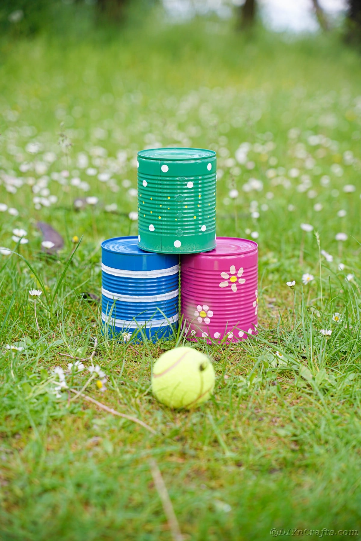 Painted tin cans sitting on grass