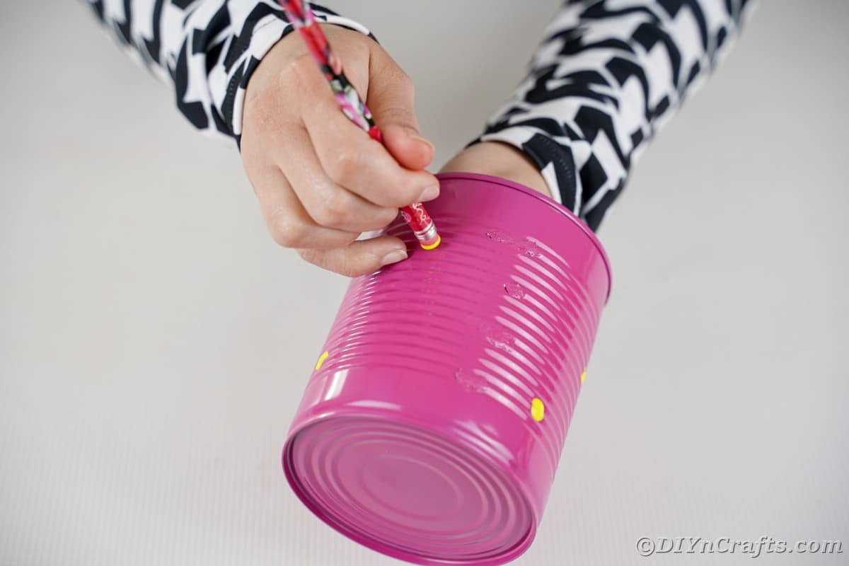 Painting yellow dots on can