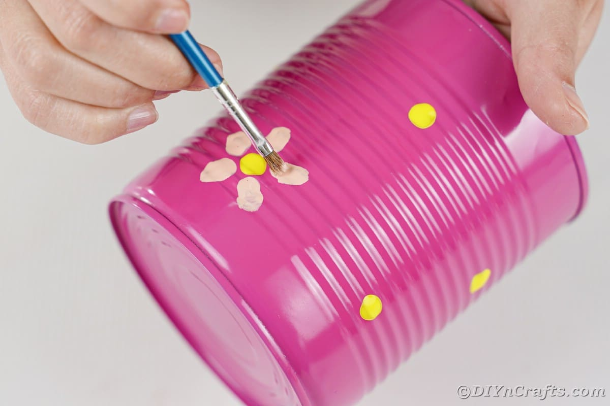 Adding pink petals to yellow flowers on pink can