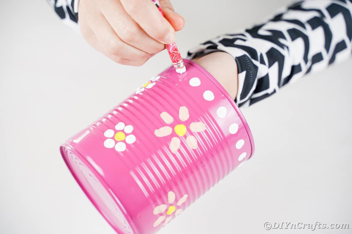 Painting white dots onto pink can