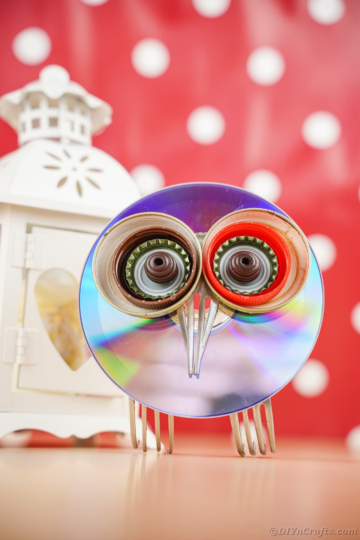 CD owl sitting on table