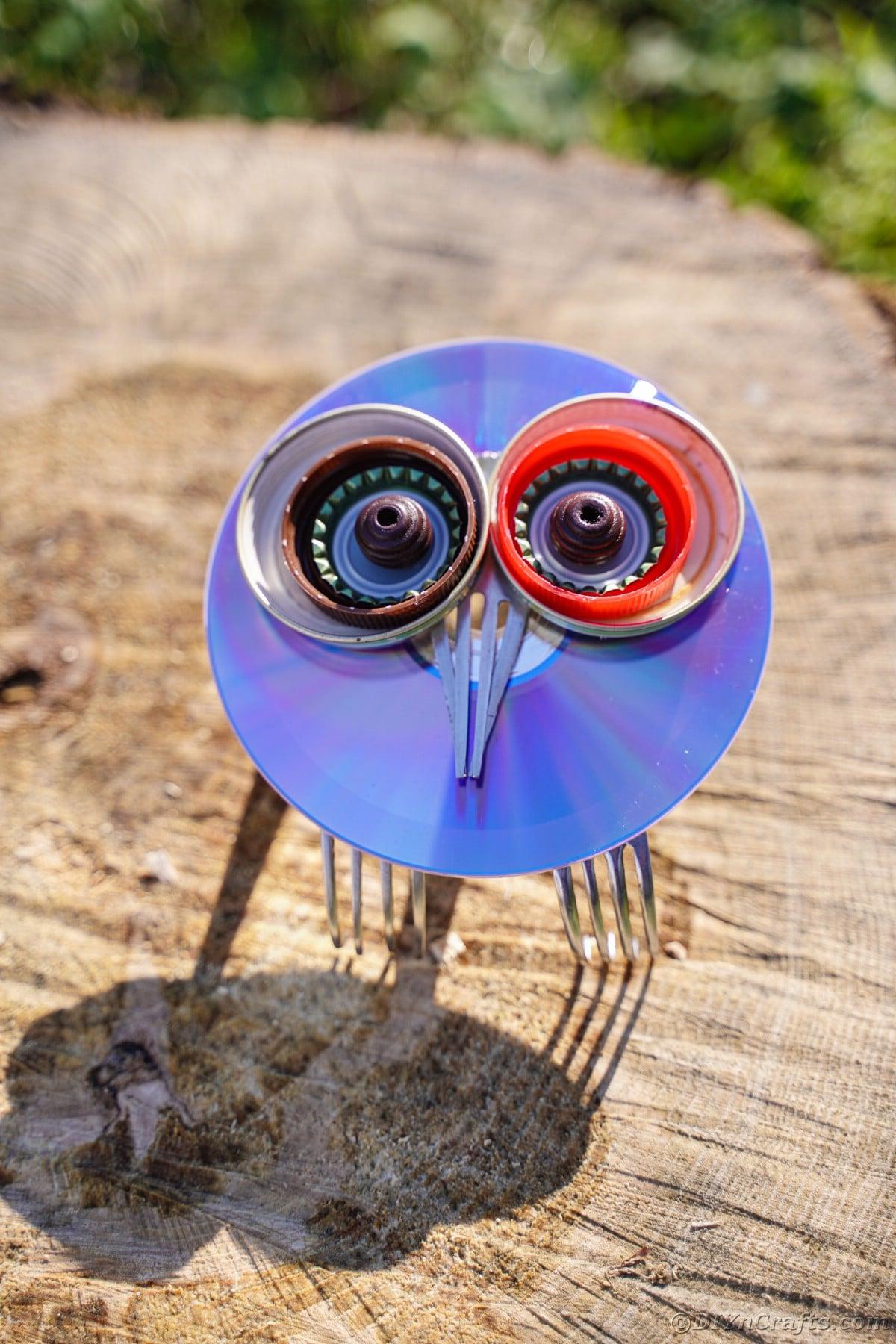 Colorful CD owl sittin gon wooden stump