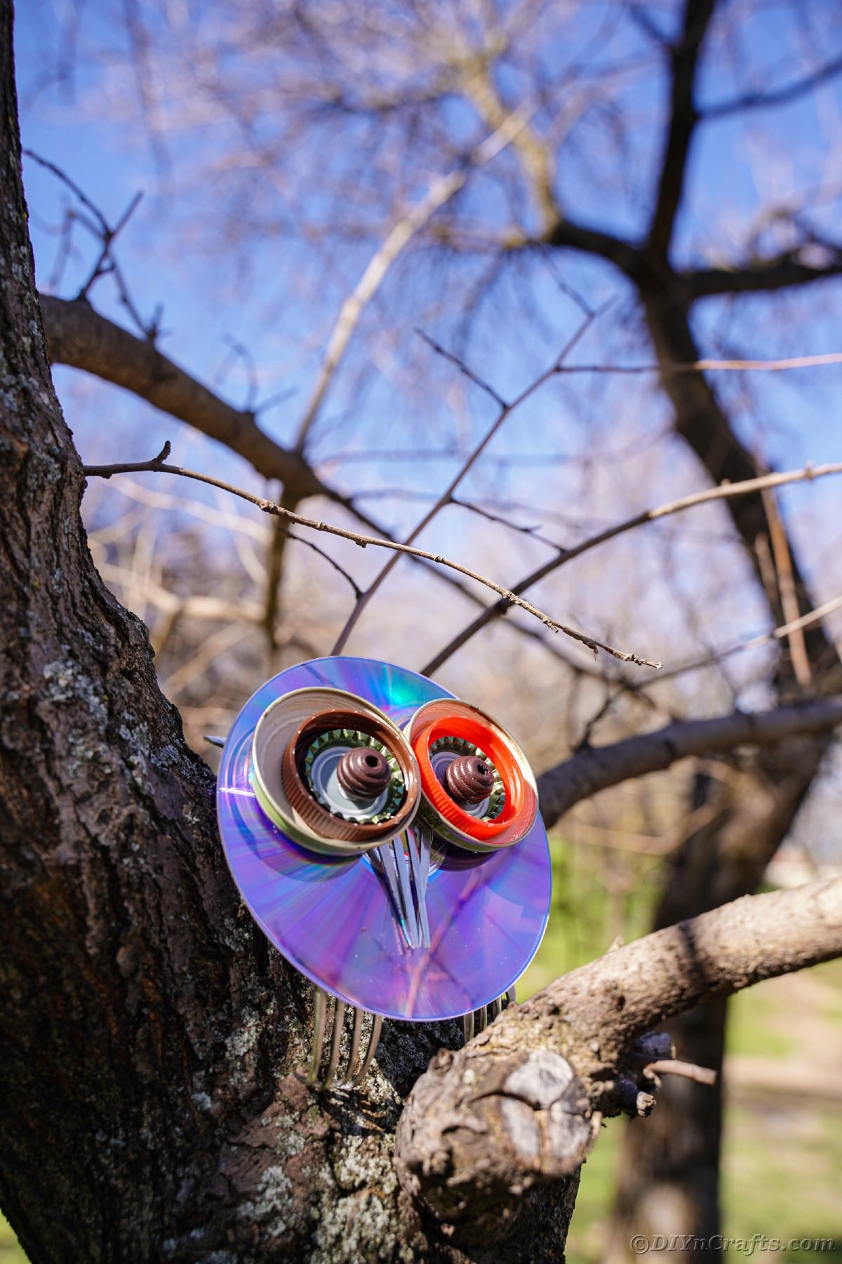 Owl made from upcycled items in tree