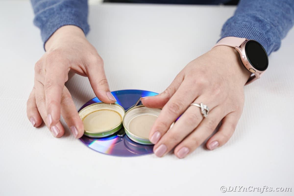 Gluing lids onto CD