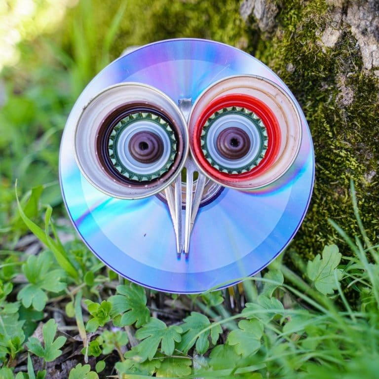 Upcycled CD and fork garden owl by tree