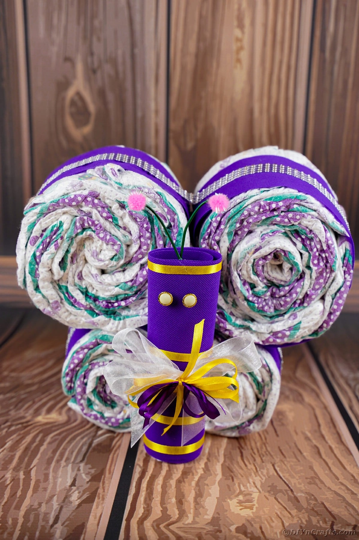 Diaper butterfly with purple body and yellow accents
