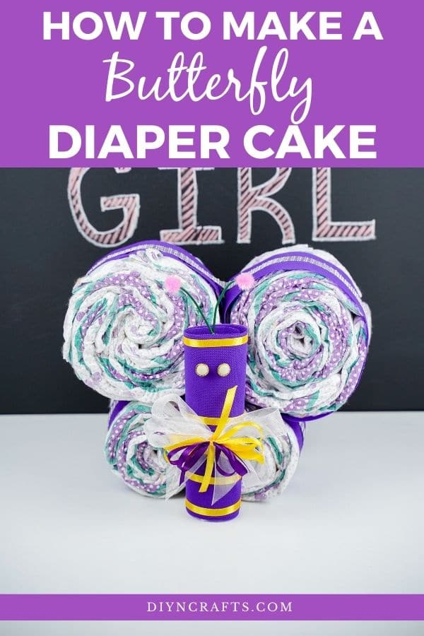 butterfly in front of chalkboard with purple overlay on image saying how to make a butterfly diaper cake