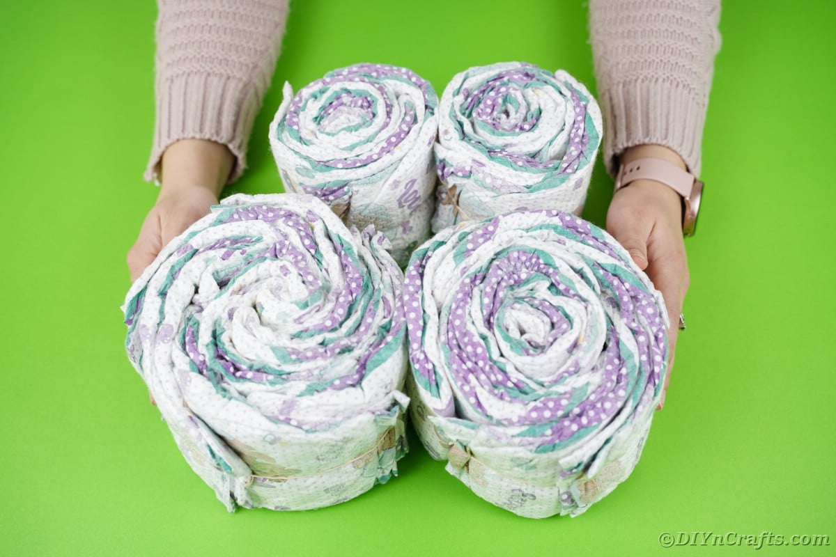 4 rolls of diapers stacked by each other