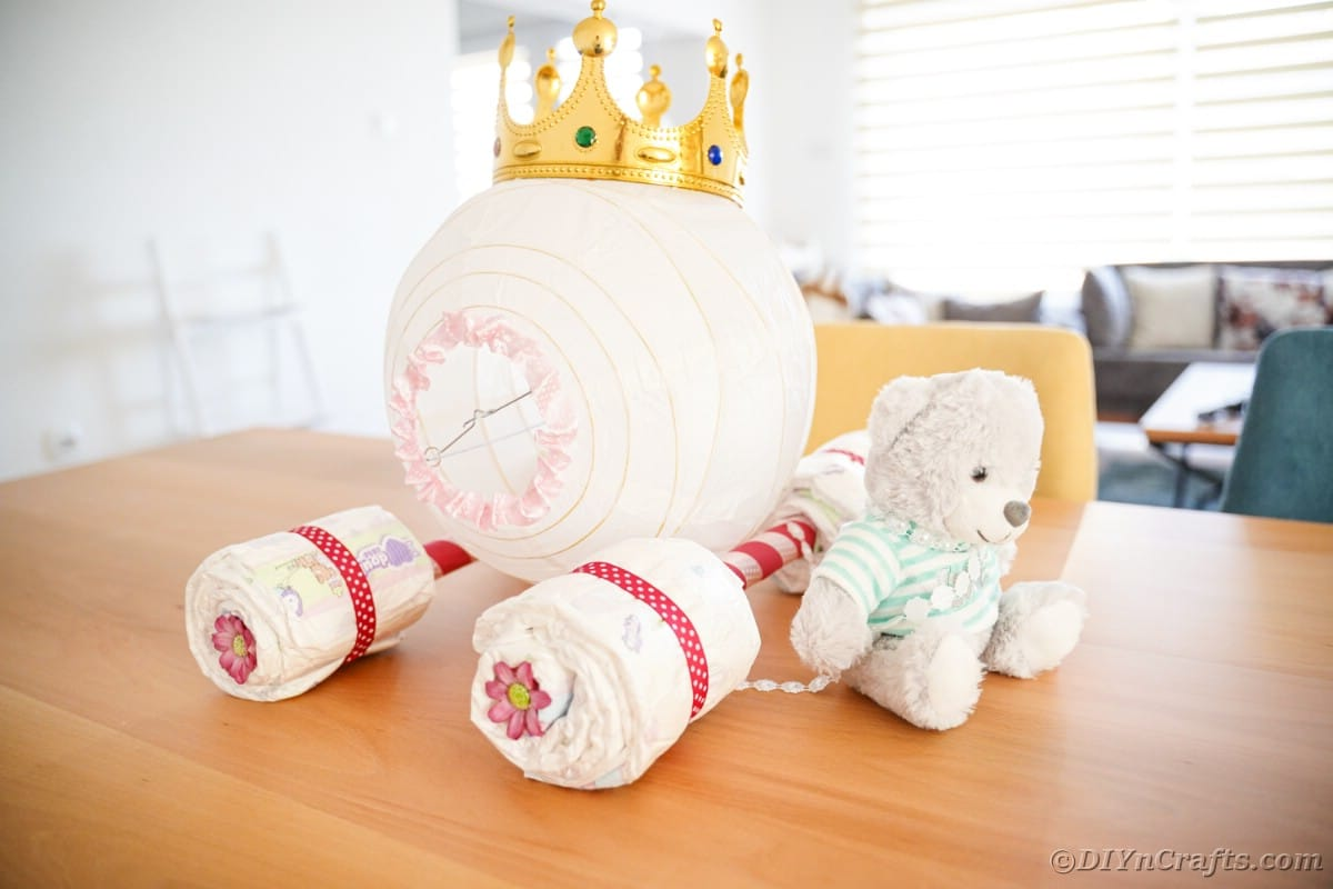 Carriage diaper cake on kitchen table