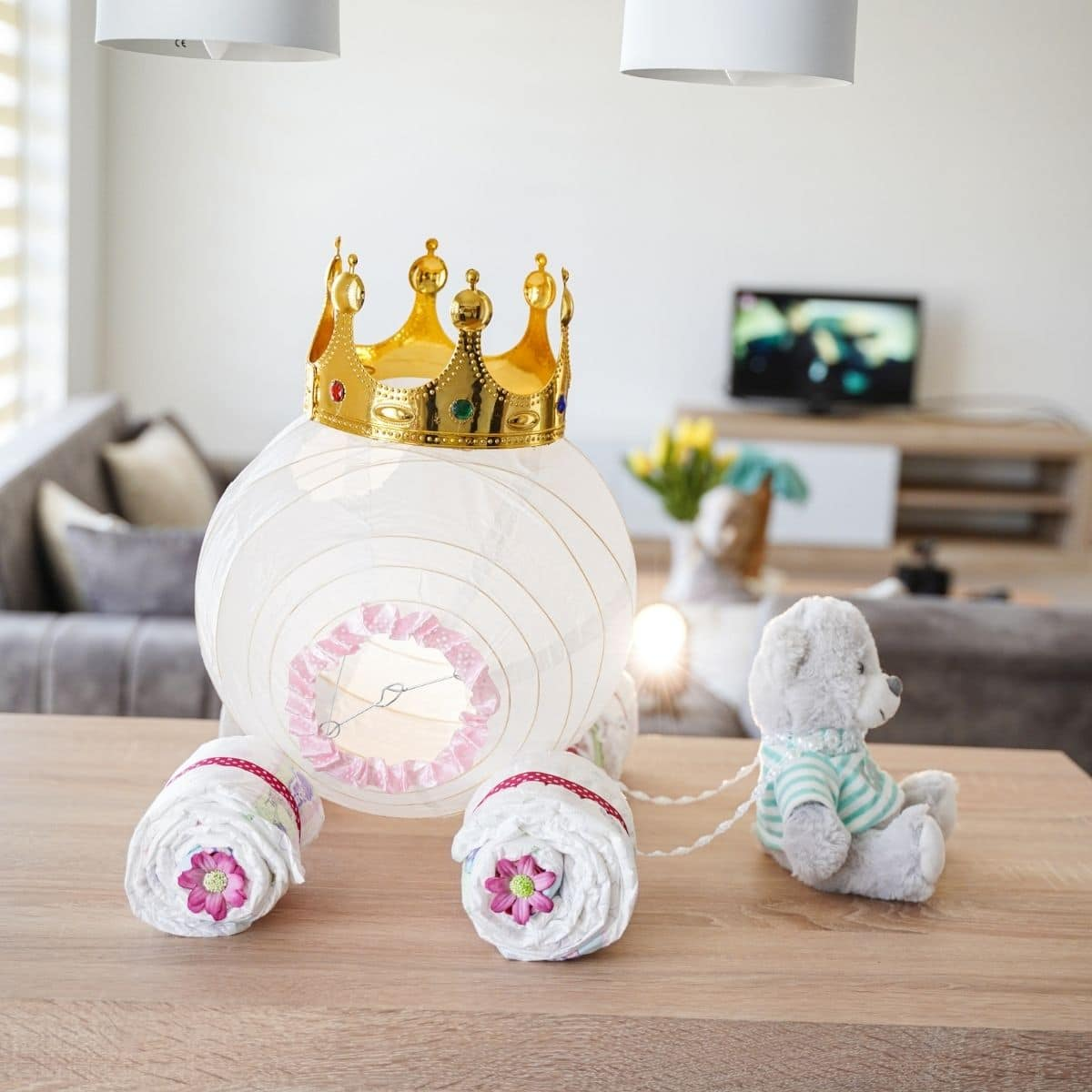 Paper lantern with crown on top on table