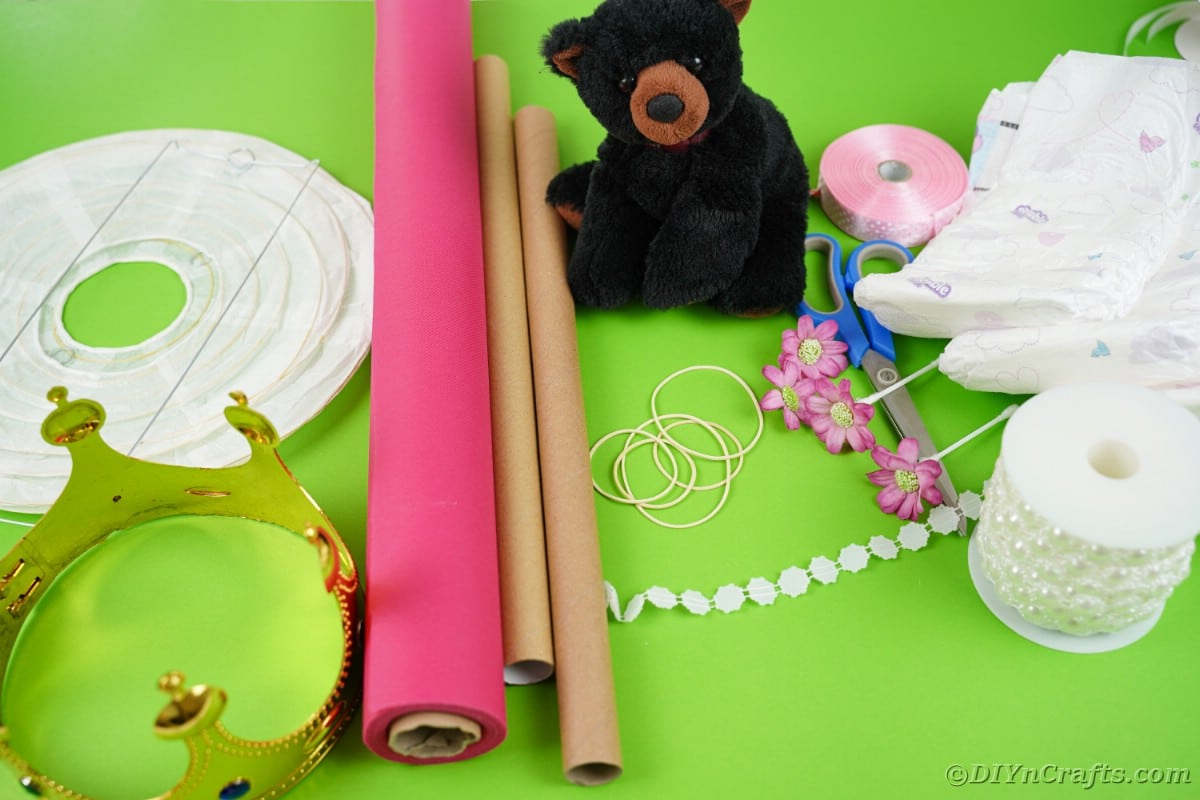 Paper lantern crown pink paper and bear on green table