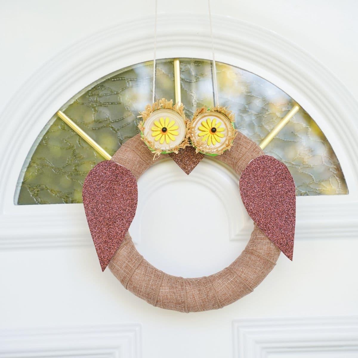 Owl wreath on white door
