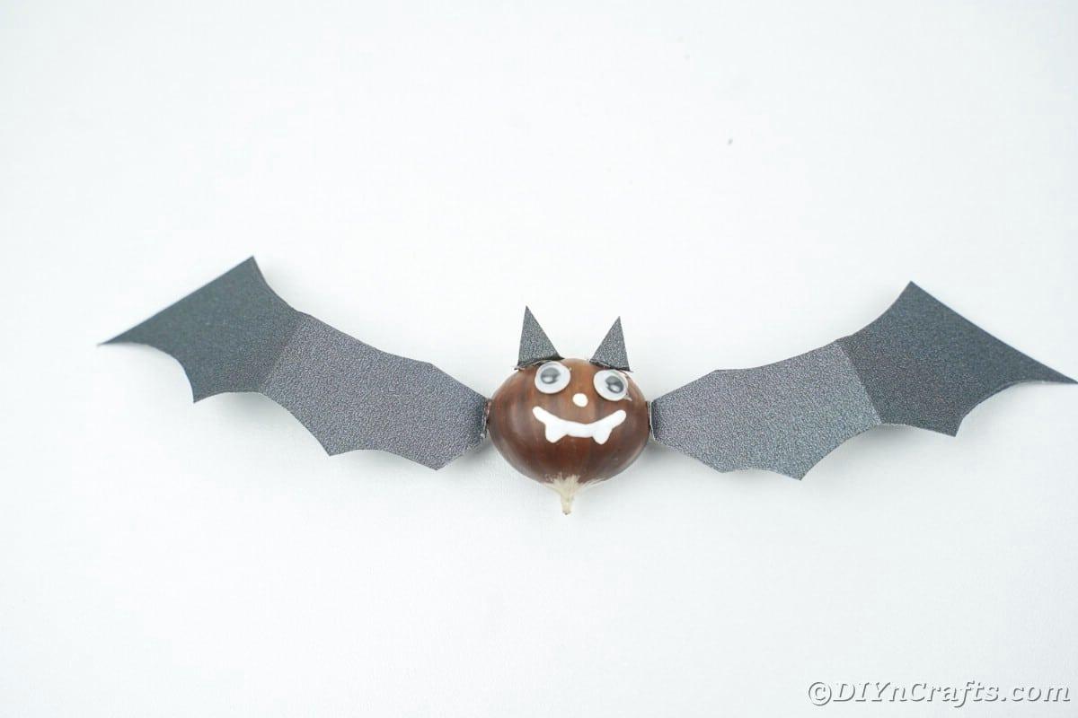 Black craft bat on white table