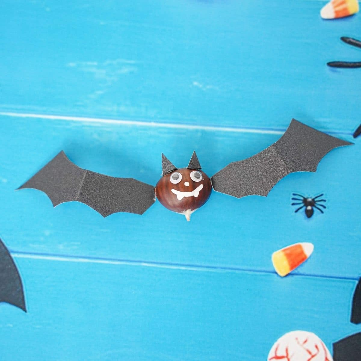 Halloween bat decoration on blue table