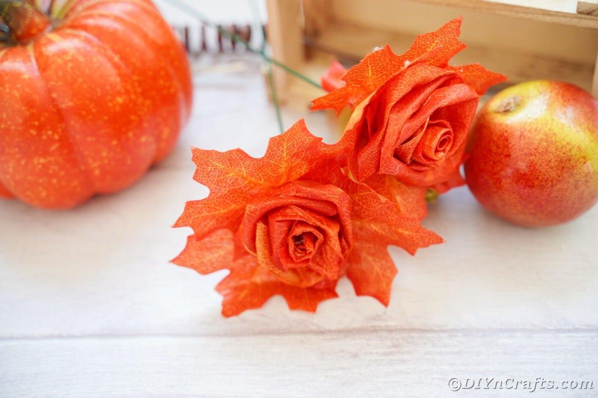 Fake leaf roses on white table