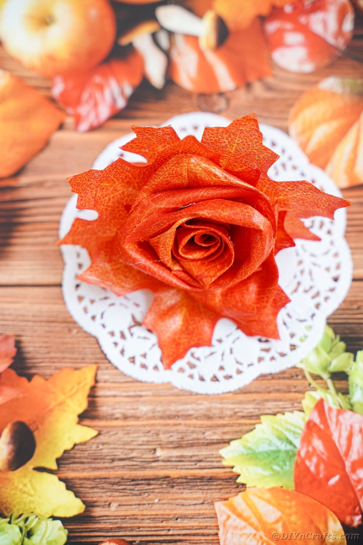 Fake rose made from leaves on fall themed paper