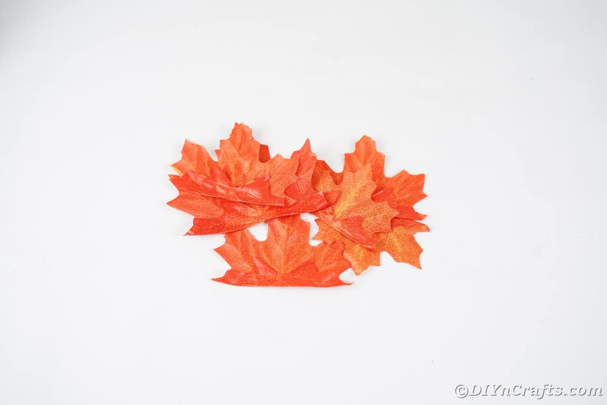 Pile of fake leaves on white table