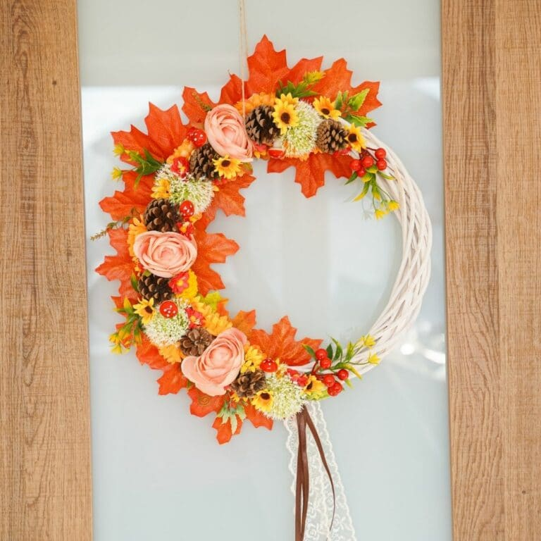 Floral and fall leaf wreath on glass door with wood trim