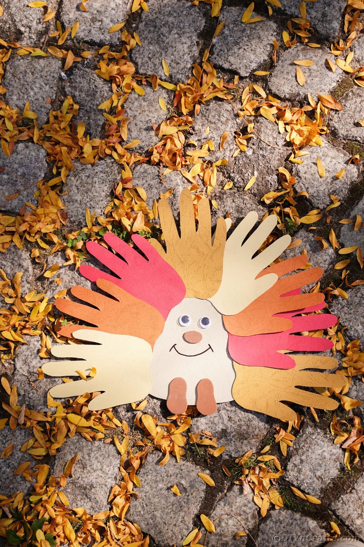 Yellow leaves on rocks by handpritn hedgehog