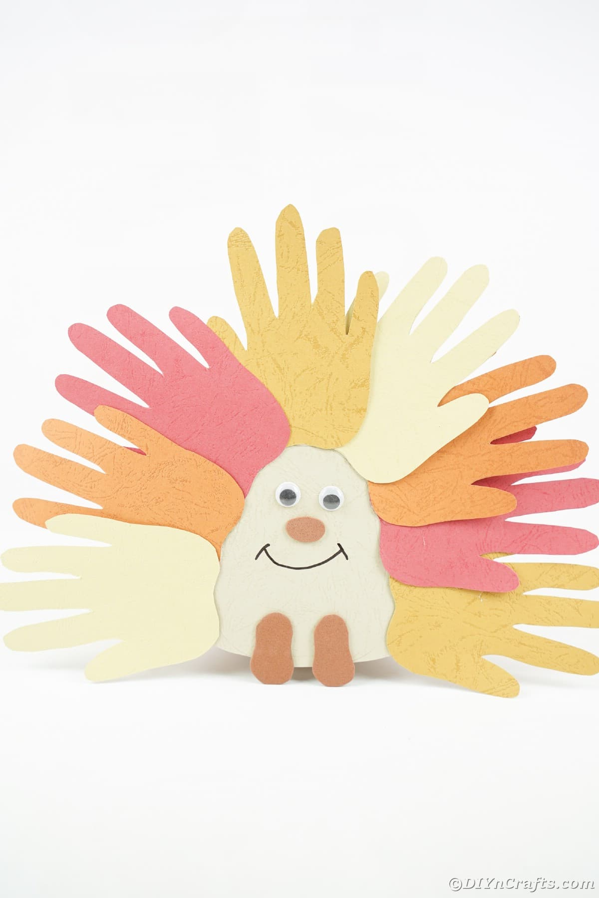 Fall colored handprint animal on white background