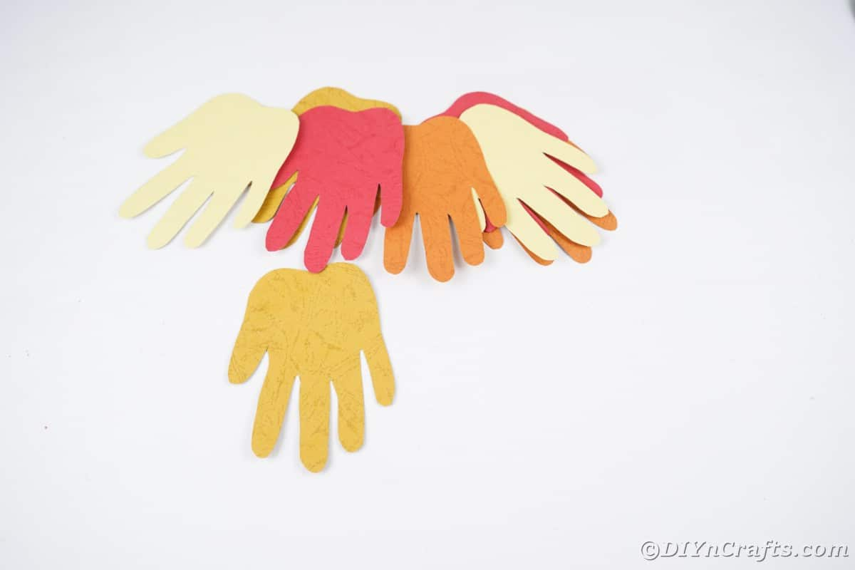 A pile of paper hands on white table