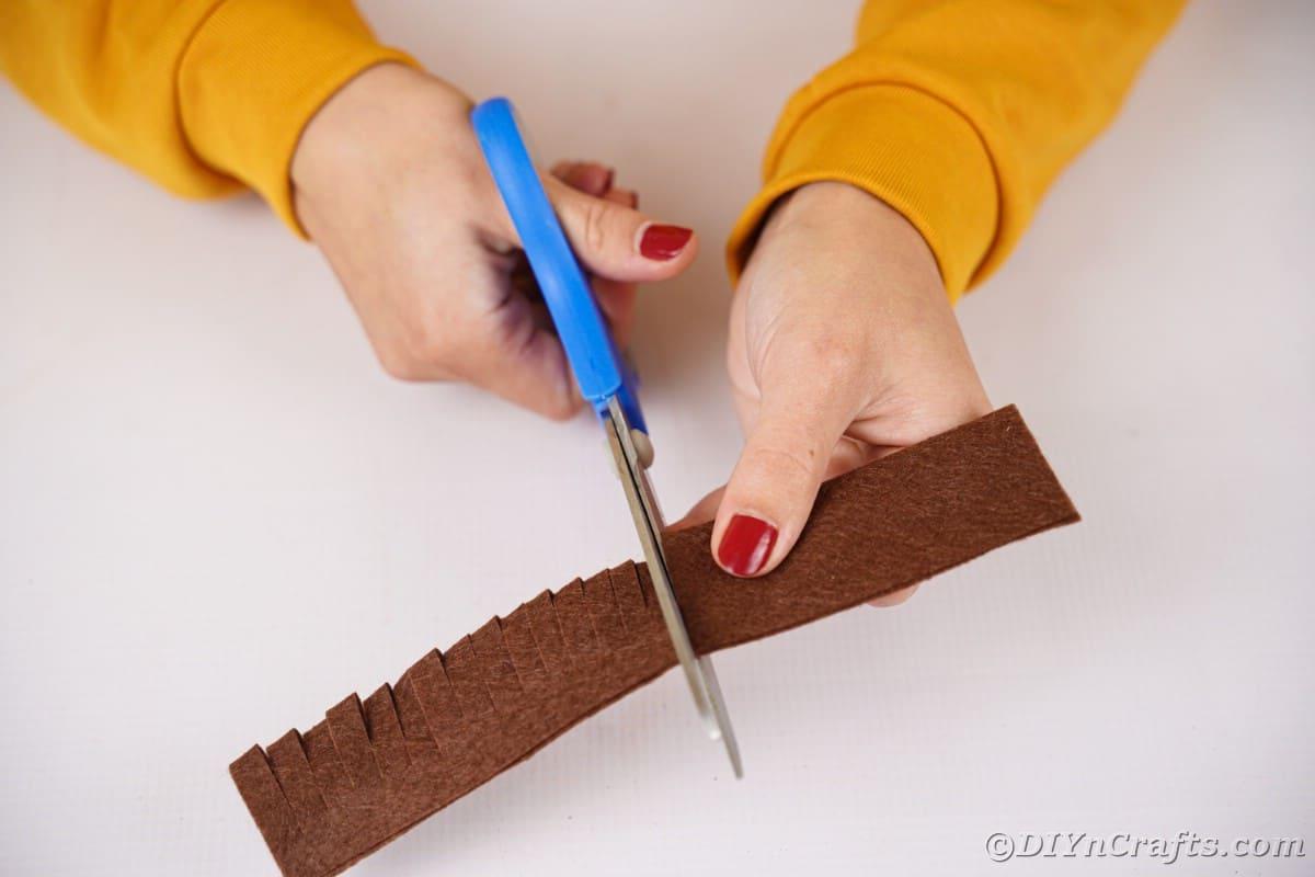 Hand cutting strips in the felt piece