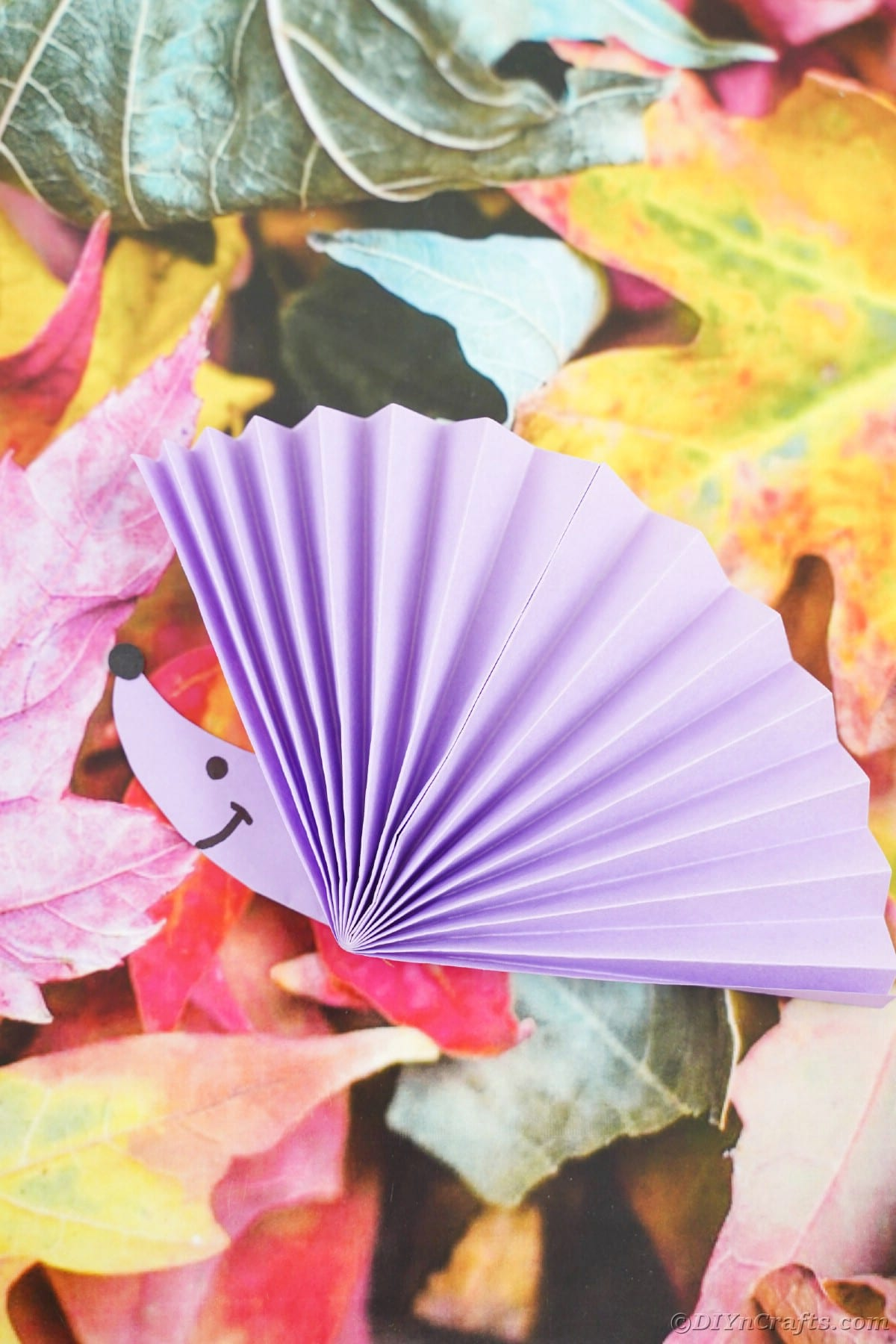 Fake leaf paper with purple fan on top