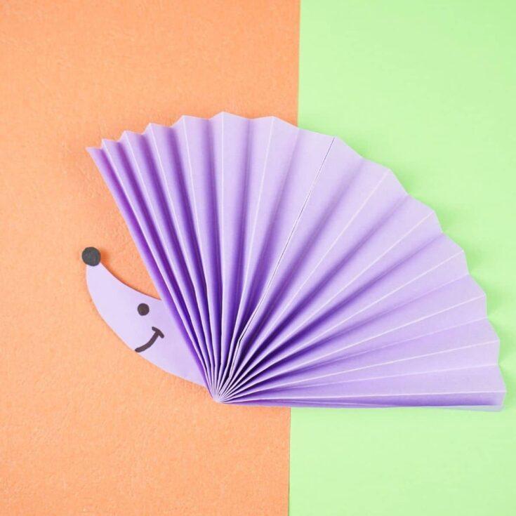 Purple fan hedgehog on green and orange paper
