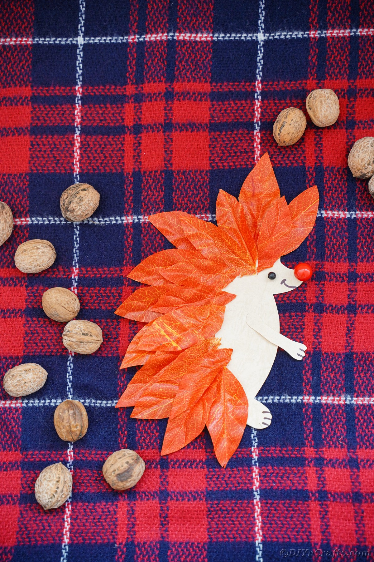 Red and blue plaid fabric under paper hedgehog