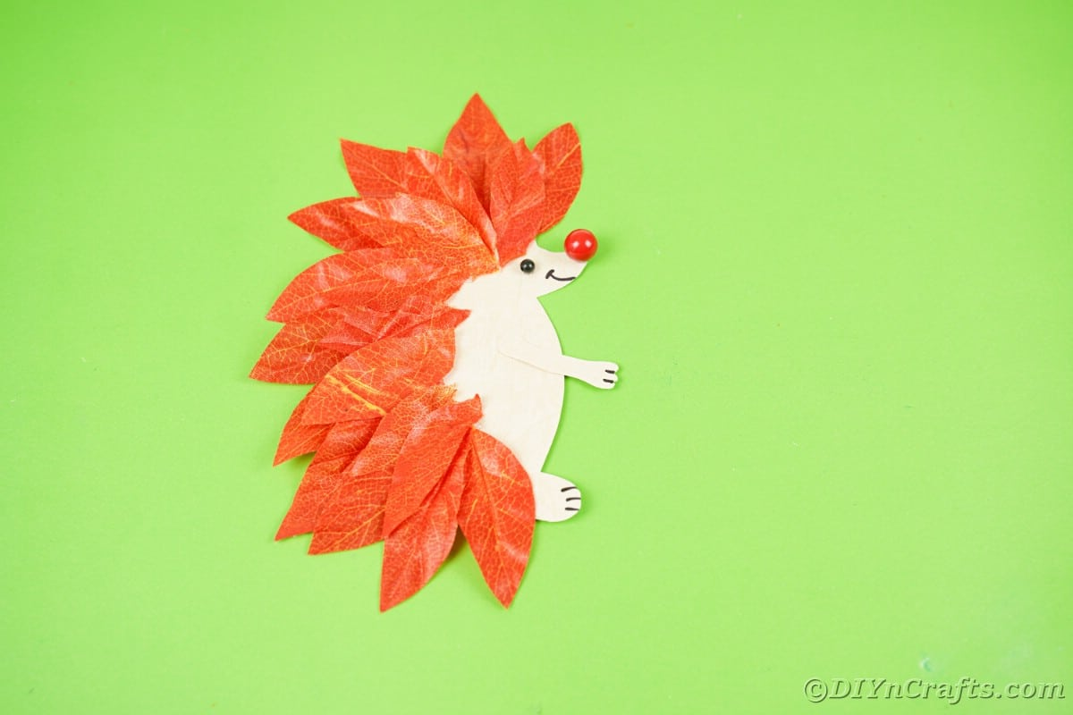 Paper hedgehog on green table