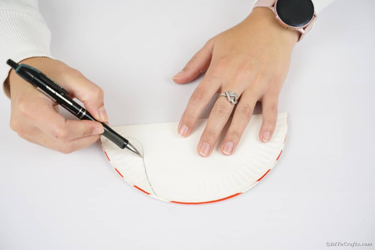 Hand drawing on halved paper plate