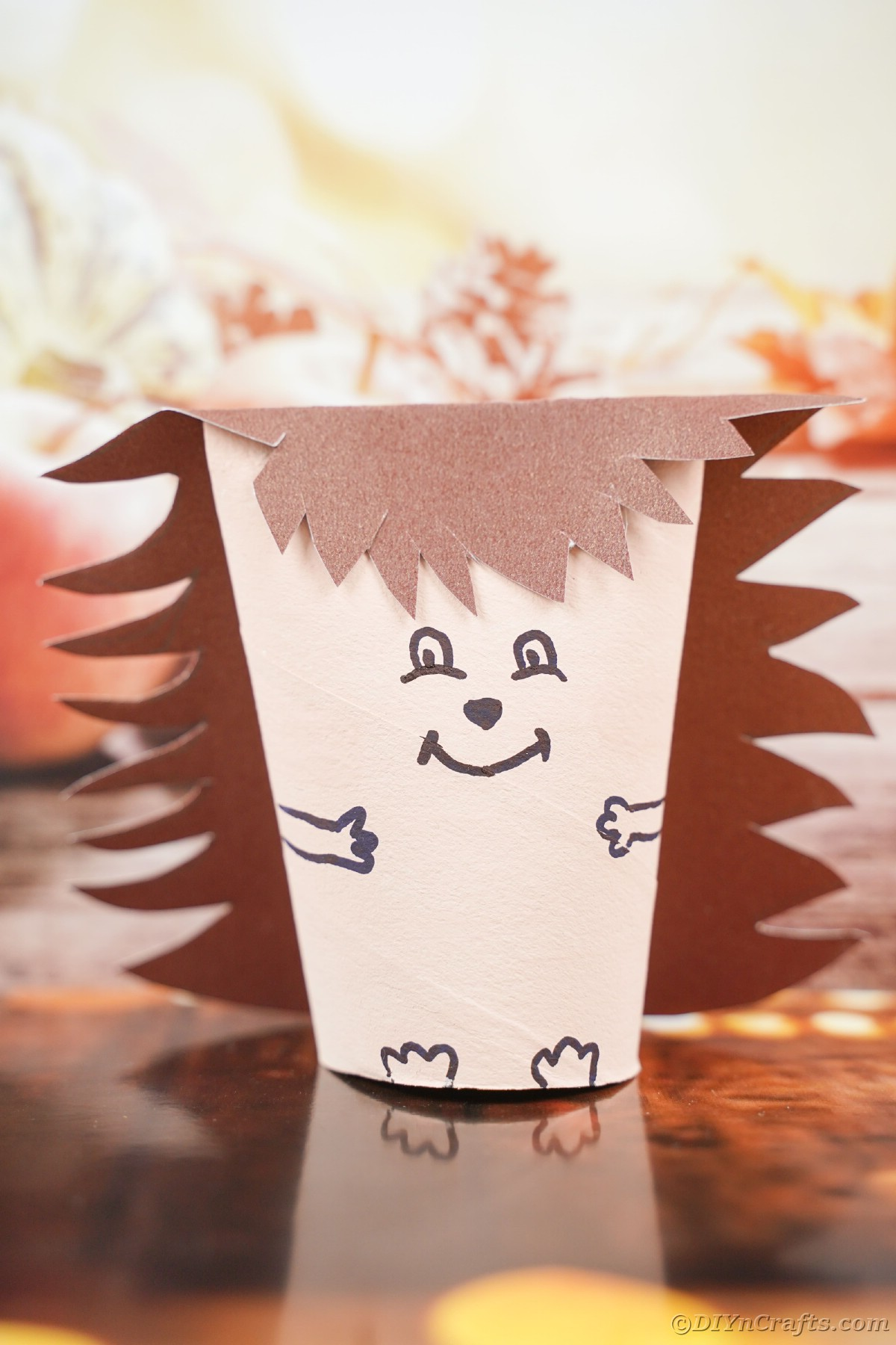 Fake hedgehog made from paper roll on table