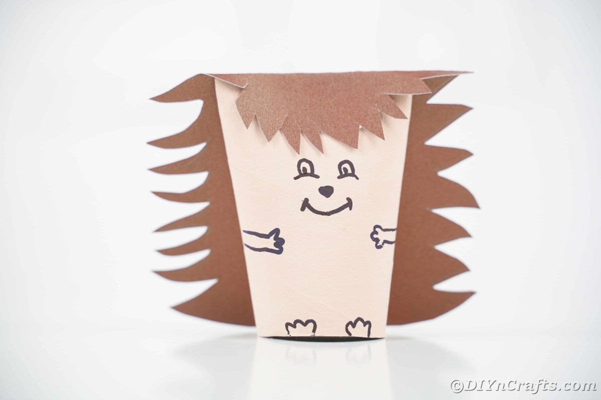 Paper roll hedgehog sitting on white table