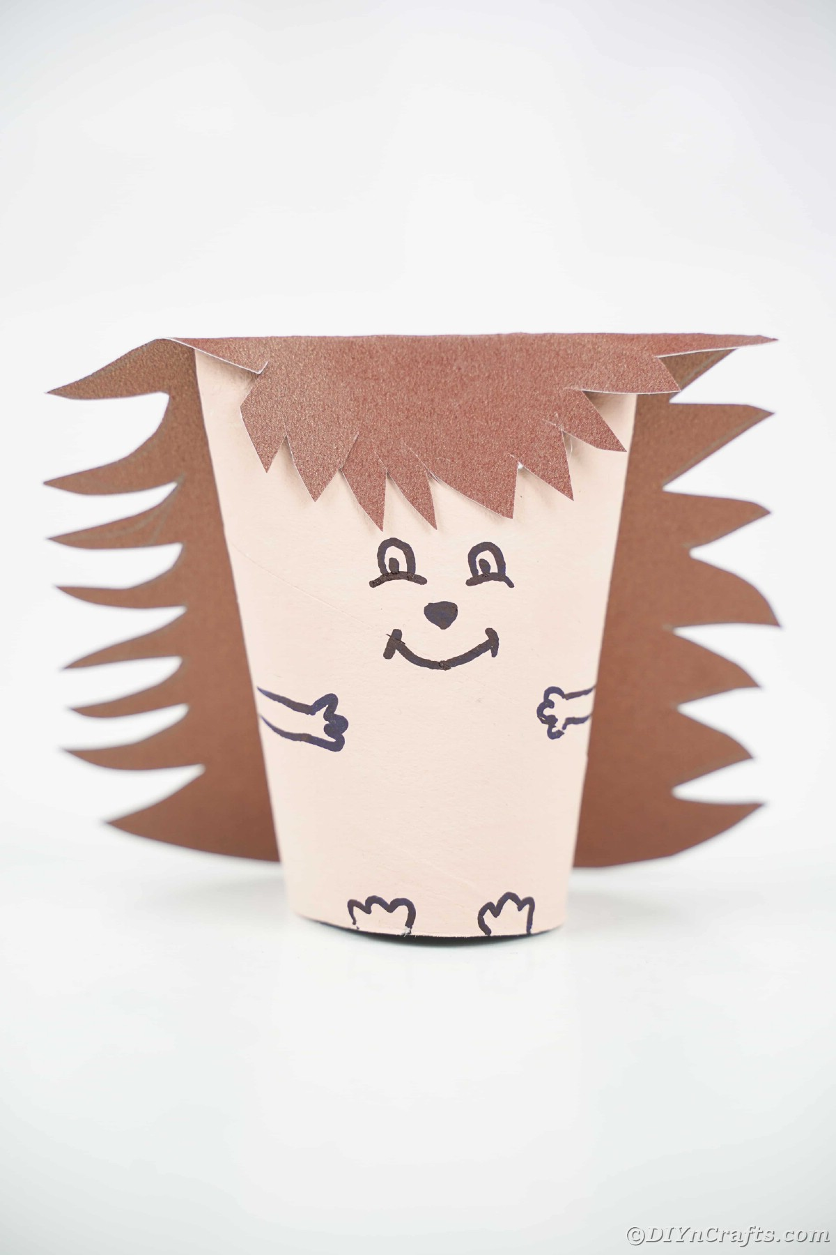 Brown painted toilet paper roll hedgehog on white table