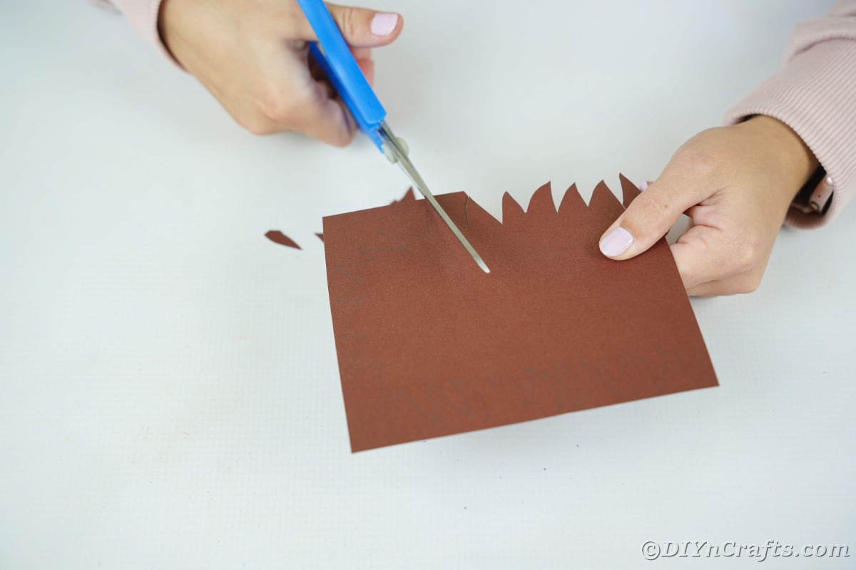 Cutting spikes onto brown paper