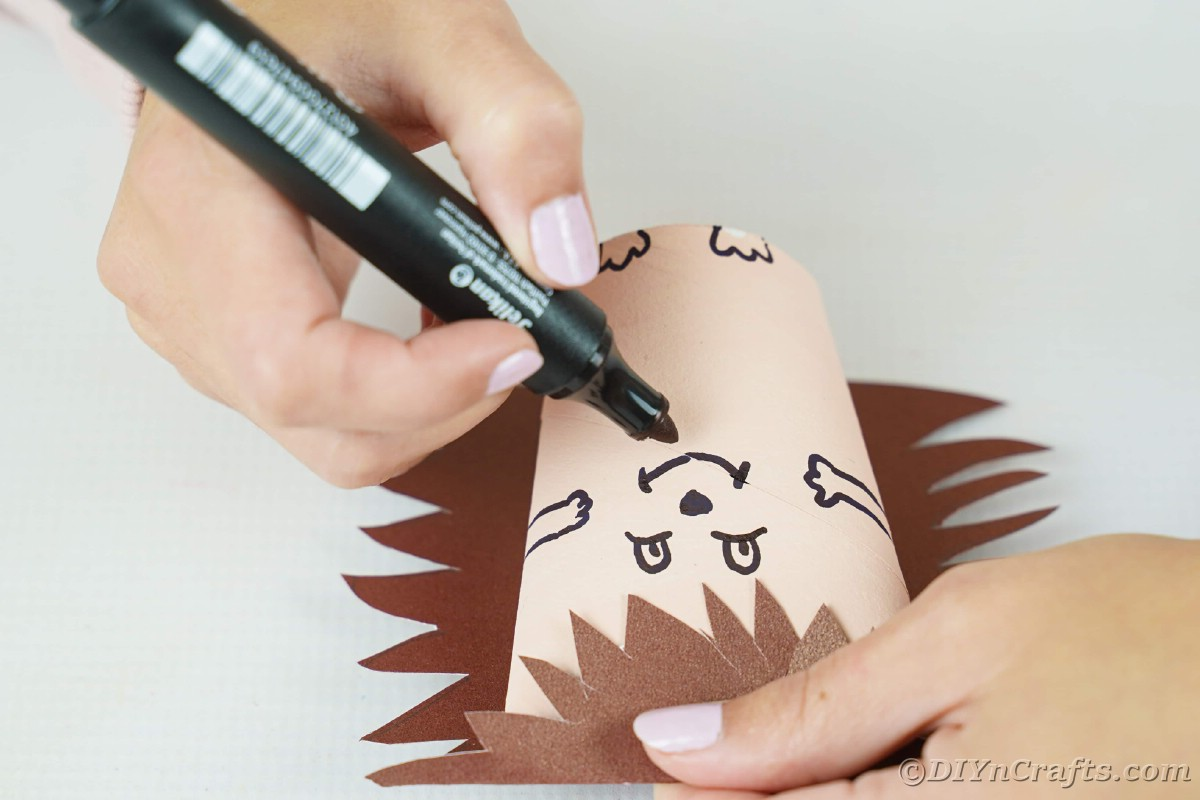 Hand drawing face on paper hedgehog