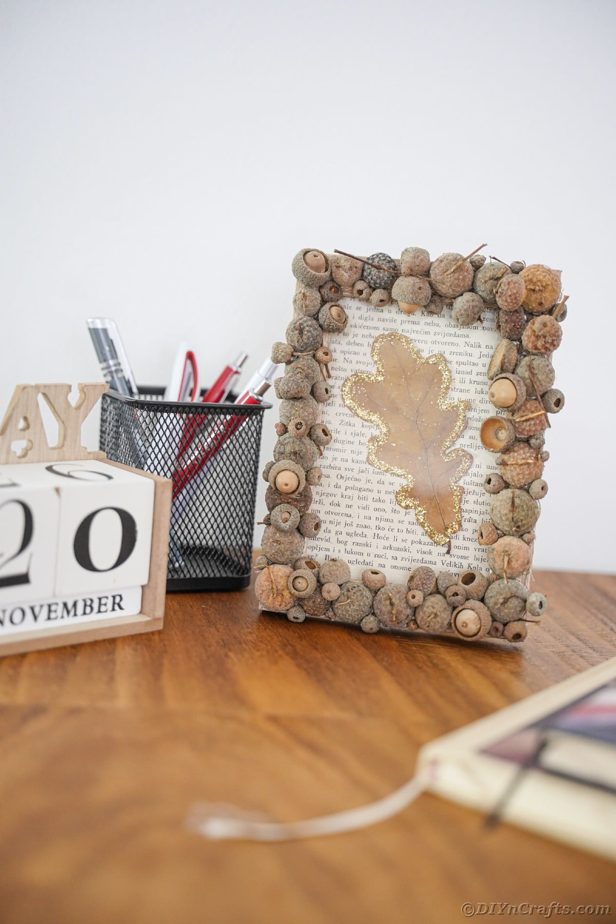 Desk with calendar blocks next to rustic picture frame