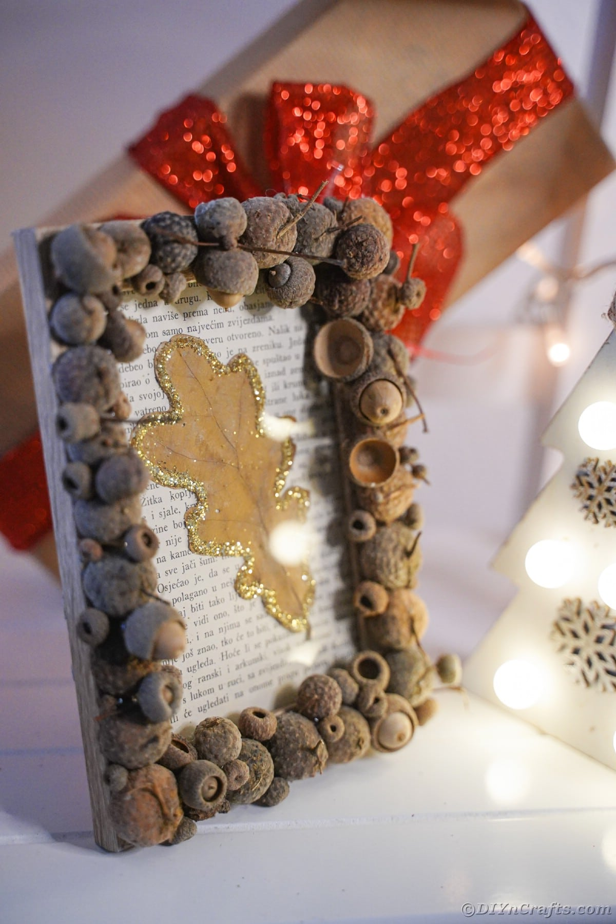 Rustic picture frame on white table with gifts