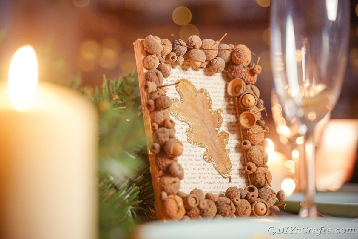 Rustic framed book page with glitter leaf