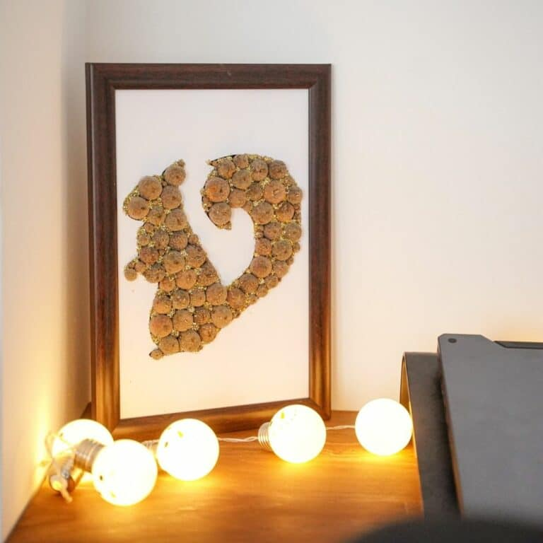 Squirrel wall art behind white lights against wall