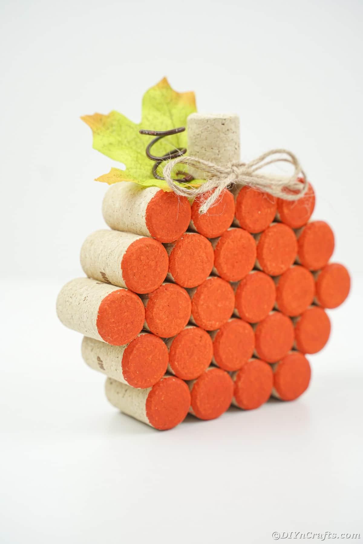 orange pumpkin made of cork on white table