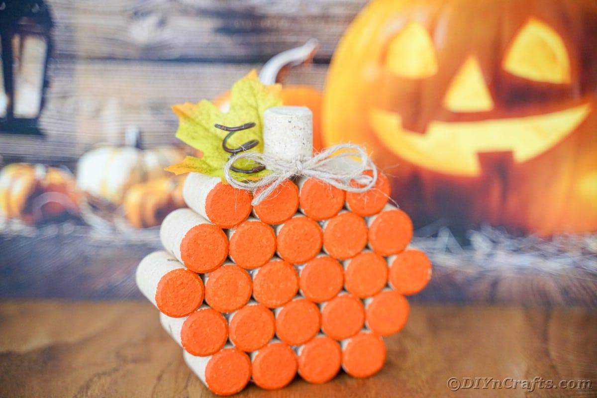 cork pumpkin in front of jack o lantern paper